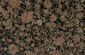 Rudi's Choice Granite - Baltic Brown. The patterning of Baltic Brown Granite makes this a memorable granite. Reminiscent of lava bubbles stopped in time, Baltic Brown granite exhibits bubbles of ochre with tinges of green on a black canvas. Something about the patterning on each slab also reminds one of a large cork board, which could make for an eye-catching feature wall in a living room or study area. Avoid using Baltic Brown alongside other materials with striking patterning to avoid visually overloading the space.