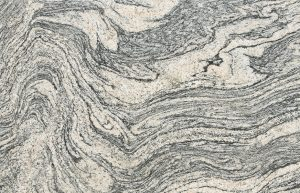 Rudi's Choice Granite - Chinese Juperana with flowing motifs in taupe and charcoal black, this highly exotic granite's large-format, textured patterns are reminiscent of van Gogh's Starry Night sky. One of nature's more flamboyant stones, be sure to visit your nearest Rudi's Choice distributor to select your favourite slabs of Chinese Juperana in person.