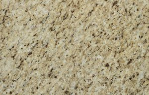 Rudi's Choice Granite - Giallo Ornamentale. This granite should have been named after a cup of coffee. Latte, coffee bean and milk chocolate are the predominent tones in this traditionally patterned slab of granite, which exhibits strong movement across each slab. Like most granites, this slab comes with a polished finish and requires regular maintenance and sealing in order to prevent stains.