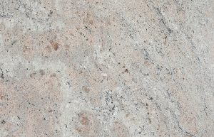 Rudi's Choice Granite - Ivory Pearl granite is the most romantic of all the contemporary granites with its blush tones and swirling movement. The pinkish undertones with black accents help to create the feeling of the first glimpses of a brilliant, cloudy sunrise. Traditional granite lovers may not enjoy this otherworldly stone, but we can easily picture this granite theme incorporated into a lady's boudoir, a timeless bathroom vanity or a feminine bedroom design.