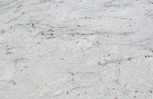 Rudi's Choice Granite - Kashmir Valley is the first cousin of Amba White granite. Although it expresses a similar colour palette to Amba White, Kashmir Valley granite has more consistent patterning and veining, with grey streaks replacing the liquorice patterning in Amba White. The cranberry pieces on a snow white background are the consistent elements across both colours.