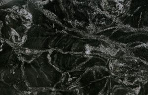 Rudi's Choice Granite - Silver Paradiso granite can often be confused with marble due to its swirling patterns and fine graining. However, on close inspection it becomes easier to discern the grainy patterning that is one of the defining differences between the two natural stones. This liquorice and cream surface carries a contemporary, masculine flavour with its bold, contrasting colour palette and would work well in a bachelor pad, a retail space or ultra-modern kitchen or bathroom design.