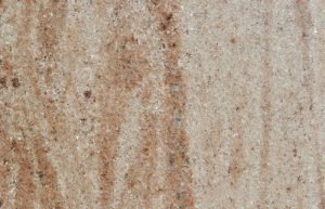Rudi's Choice Granite - Vyara Gold is elegant, imported granite named after the district headquarters of the Tapi district in the Indian state of Gujarat. The bright orange and muted red tones swathe each slab with gentle waves on a cream background. Vyara Gold's contemporary granite appeal will suit a modern interior, but as with all natural stone, it does require regular maintenance in order to keep it in pristine condition.